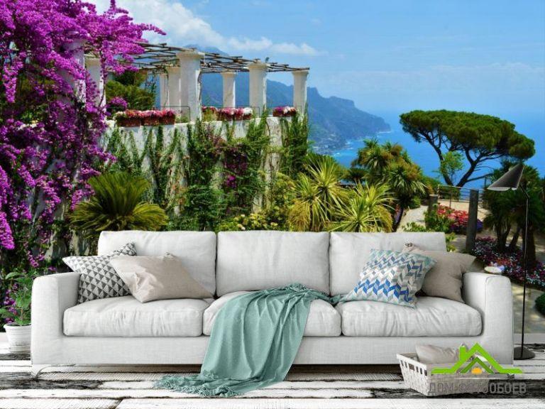 Фотообои вид на море из цветочного сада